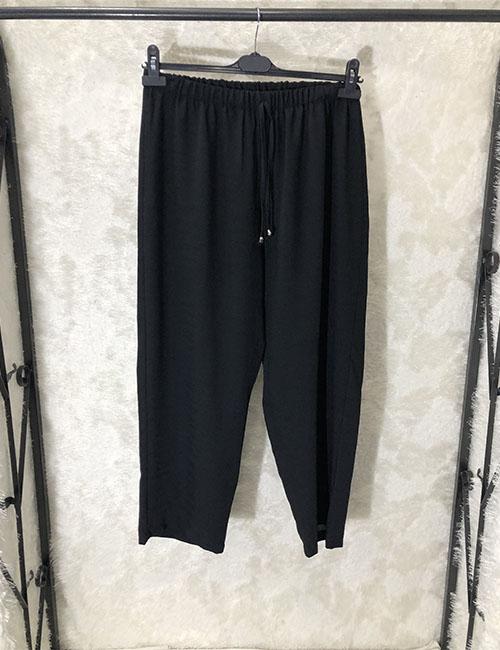 Pantallona krem ne ngjyre te zeze
